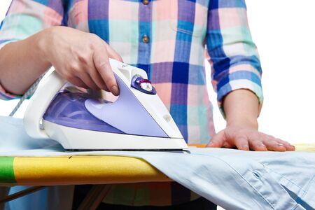 ironing board: Woman ironed shirt on the ironing board