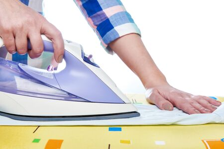 ironing board: Woman ironed shirt on the ironing board isolated