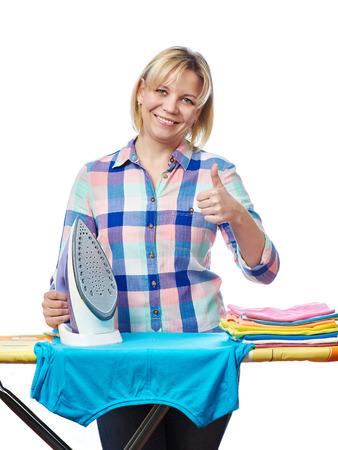 Beautiful woman housewife ironed clothes and showing thumbs up  isolated on white photo