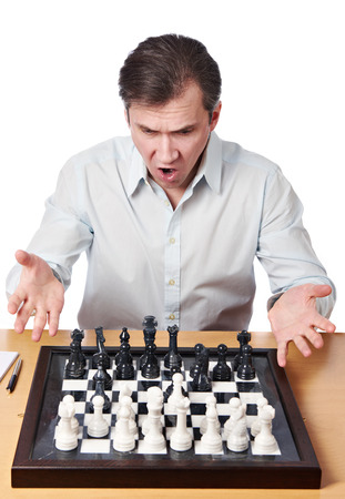 perturbed: Man emotionally perturbed game combination in chess isolated Stock Photo
