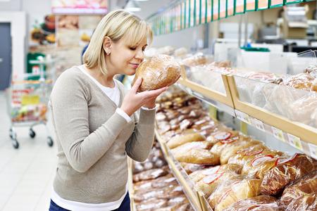Women choosing bread in supermarket photo