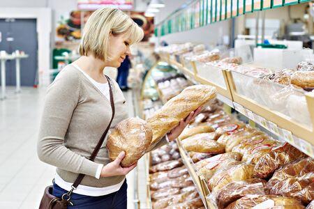 bread shop: Women choosing bread in supermarket