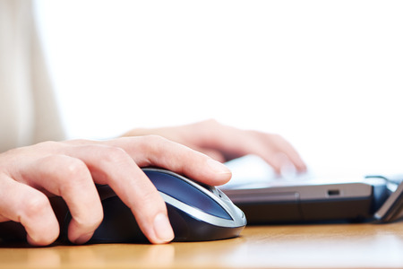 Female hand touching computer mouse closeup Stock Photo