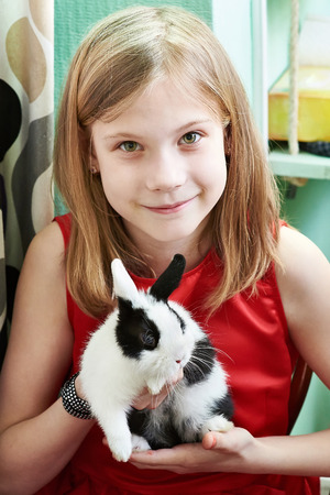 Girl with a small rabbit