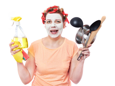 over white: Housewife with rag, roller-pin and pan over white Stock Photo