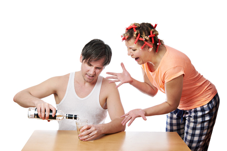 drunkenness: Family scandal because of drunkenness of her husband isolated Stock Photo