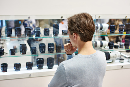 Selecting the camera lens in the store