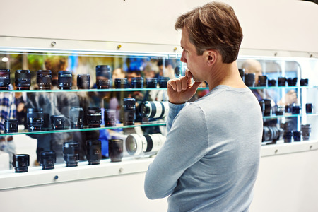 showcase: Selecting the camera lens in showcase of store