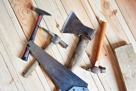 head home: Carpenter tools on wooden boards closeup