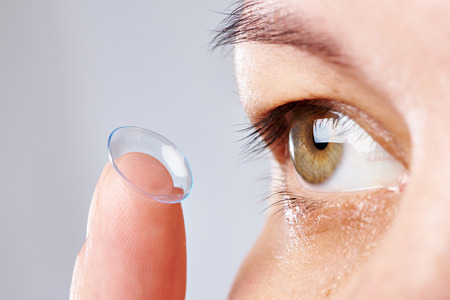 Medicine and vision - young woman with contact lens