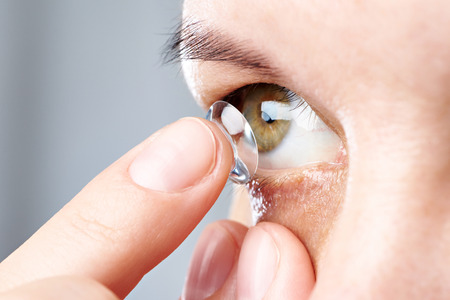 shortsighted: Medicine and vision - young woman with contact lens