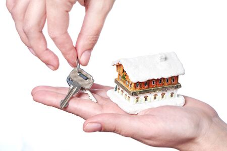 housebuilding: Hands with keys and house on white background