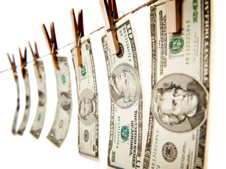 pulling money: Money on clothes line isolated on white background Stock Photo