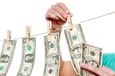 consolidate: Hand pinch money on clothes line isolated on white background