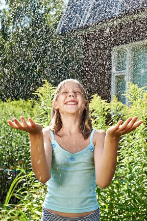 rain wet: Happy girl under summer rain