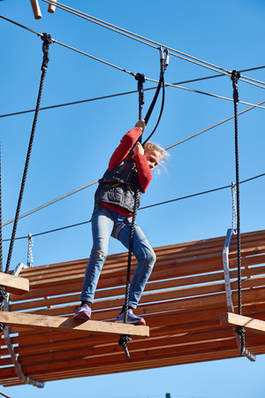 brave: Brave girl is climbing to amusement park