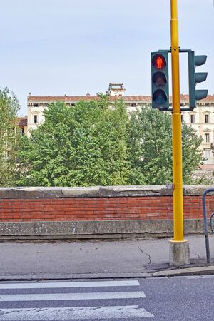 the traffic lights: Red traffic lights for pedestrians on the crossroads