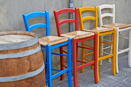 holidays vacancy: Colored chairs in street cafe Italian
