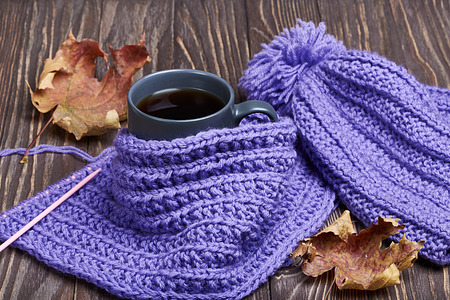 winter weather: Warm cap, scarf and hot drink in cold weather