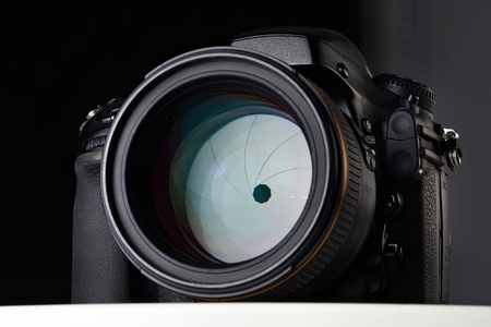 and aperture: DSLR camera with big aperture ratio lens on black
