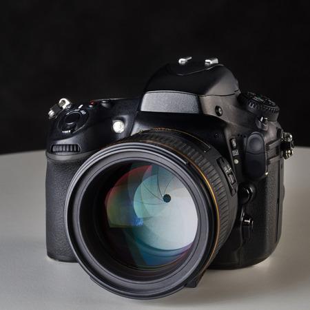 DSLR camera with big aperture ratio lens on black Reklamní fotografie
