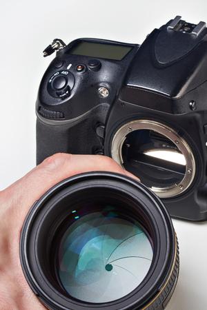 bayonet: Photographer with big lens and digital SLR camera close-up Stock Photo