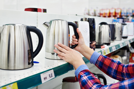 electric kettle: Woman housewife shopping for electric kettle Stock Photo