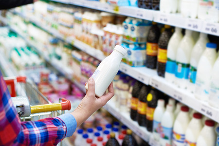 Woman shopping dairy product in grocery store Stock Photo