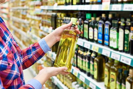 sunflower oil: Buyer with the sunflower oil in a store