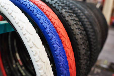 tread: New bicycle tires with different color tread close-up Stock Photo