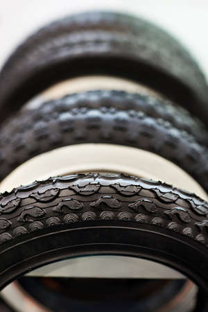 tread: New bicycle and ATV tires with different tread close-up