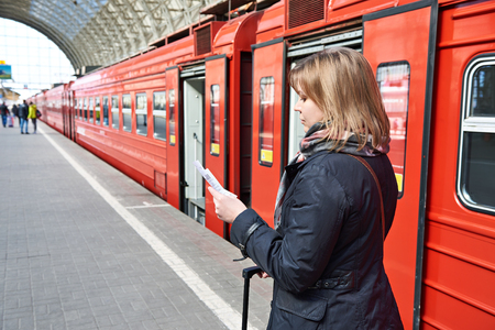 holiday maker: Woman near the train checks his ticket to the station platform