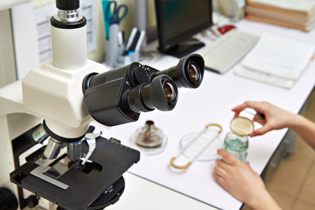 biochemical: Workplace with a microscope in a laboratory biochemical Stock Photo