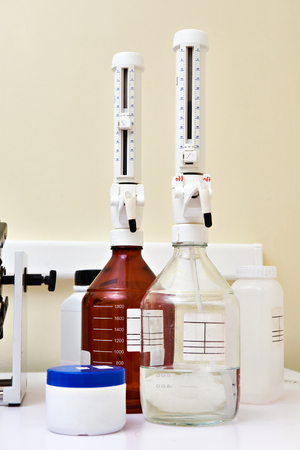 biochemical: Bottles with top dispenser in the biochemical laboratory