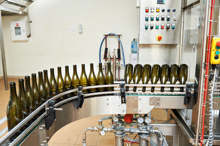 sealing: Bottling and sealing conveyor line at winery factory Stock Photo