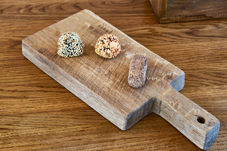 breading: Chocolate candies in the breading on a decorative cutting board
