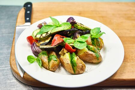 bell peppers: Roasted vegetables potato, eggplant, zucchini, bell peppers and onions on kitchen of restaurant