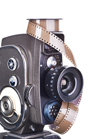 16mm: Retro mechanical hobbies movie camera and film isolated white