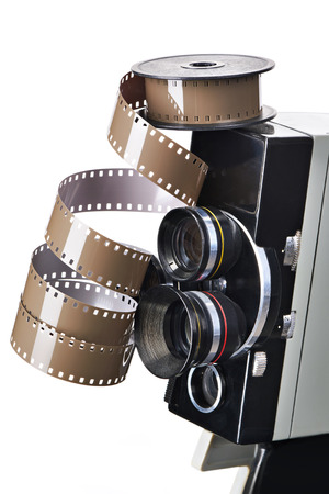 Retro mechanical movie camera and reel film isolated white