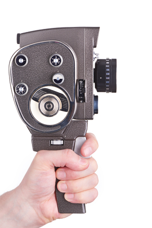 16mm: Retro mechanical hobbies movie camera in the hands of the operator isolated white Stock Photo
