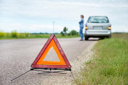 waits: Woman waits help near broken car on countryside road Stock Photo