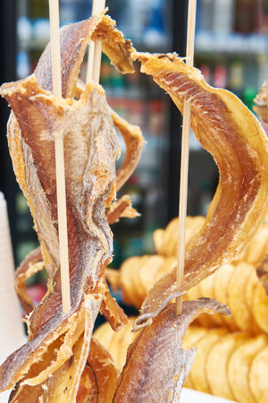 transfigure: Dried fish on wooden stick in shop