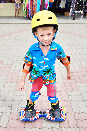 boy skating: Little boy skating on gyroscooter and smiling Stock Photo