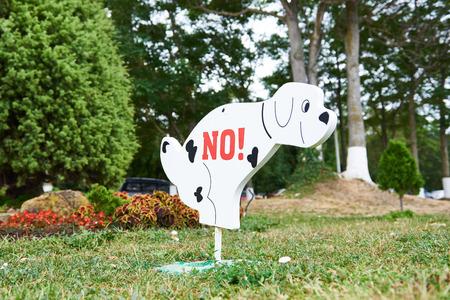 watercloset: Sign prohibiting dog walking on the lawn Stock Photo