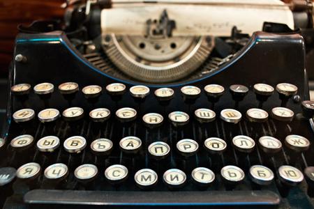 correspond: Old black retro typewriter closeup