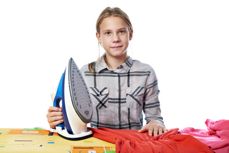 difficult lives: Girl with washed linen around the ironing board with iron isolated white