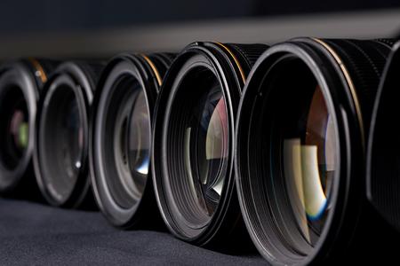 Row of photo lenses side view closeup Stock Photo