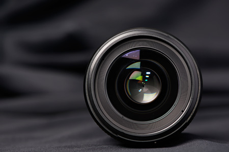 Photo lens front view on blurred background Stock Photo