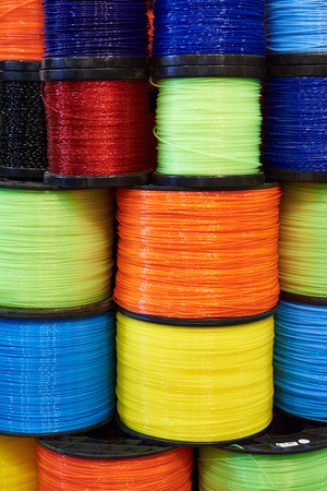 trimmer: Colorful trimmer line cord in warehouse Stock Photo