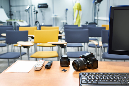 yellow notepad: Place of teacher in photography school classroom Stock Photo